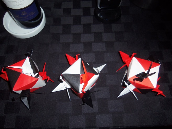 Table decorations carry the theme of black, white, and red all over, in honor of a newspaperman's advancing age.