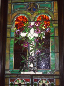 A decorative window in a social hall where our chorus rehearses.