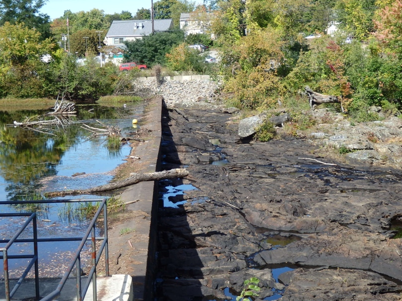 A dam atop the Great Falls connects Somersworth, New Hampshire, to Berwick, Maine. Last year's drought exposes both sides of the river.