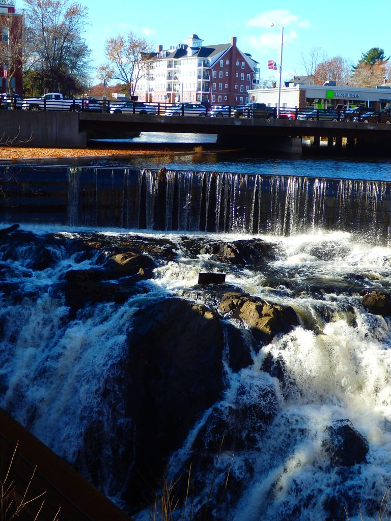 Cocheco River falls crisply over the dam and waterfalls in downtown Dover. The tide from the Atlantic Ocean reaches up to the base below.