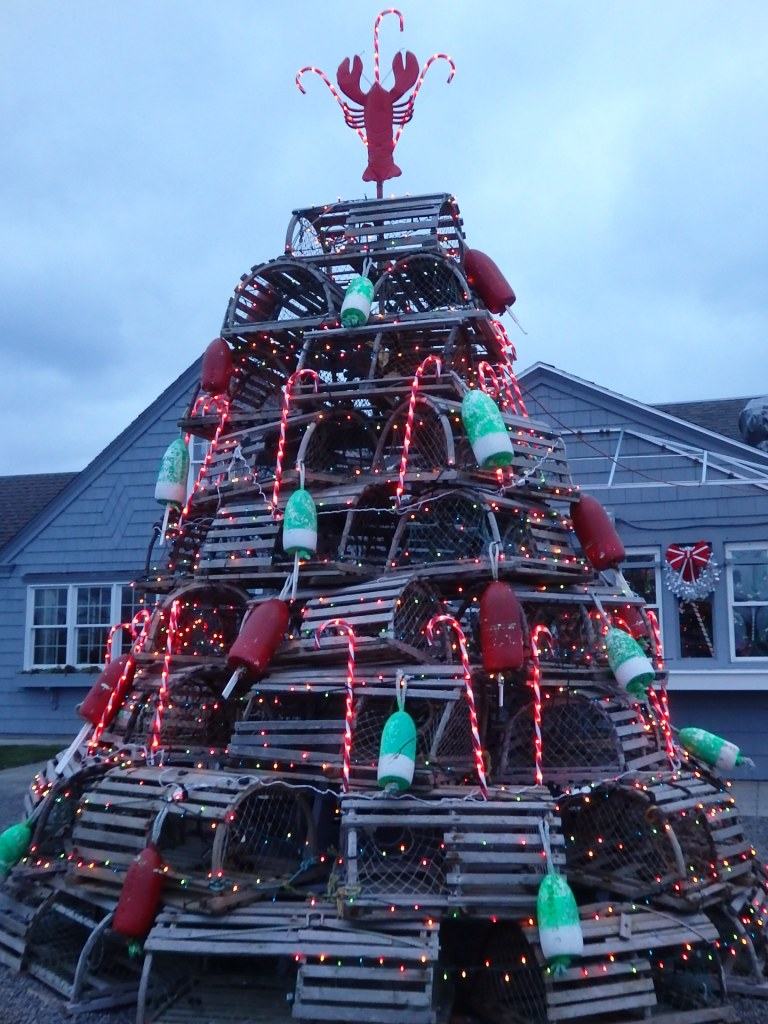Old-fashioned lobster traps are used to build a whimsical Christmas tree. This example is from Cape Neddick in York, Maine.