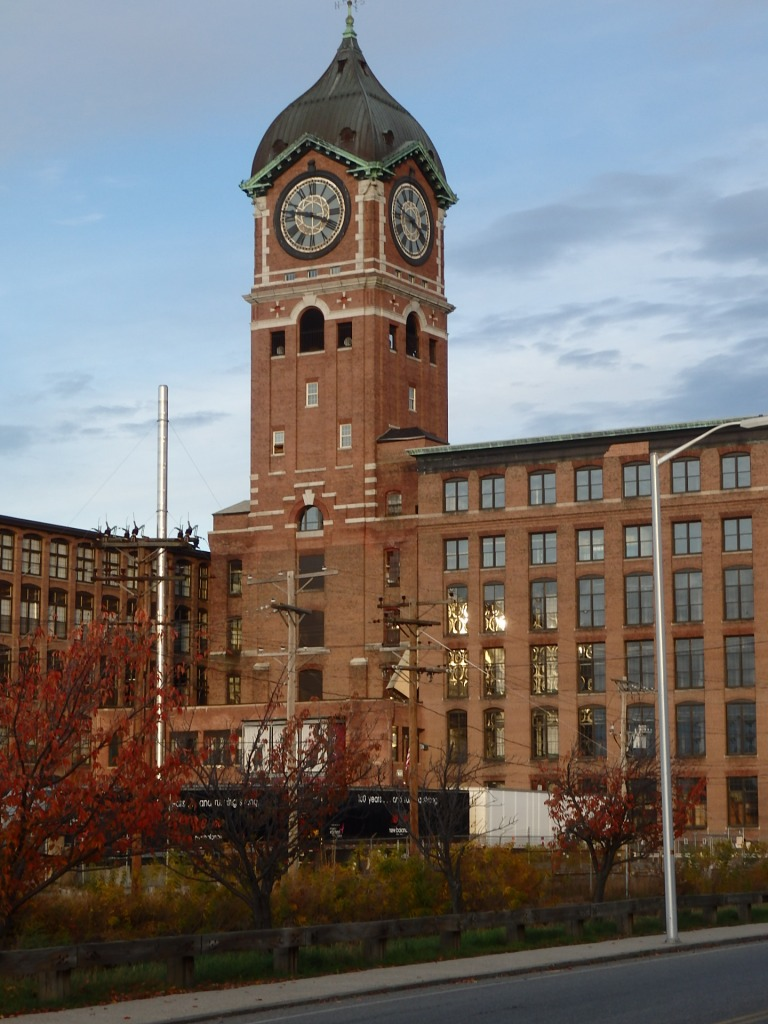 The clock tower of the Ayer Mill in Lawrence, Massachusetts, overlooks the Merrimack River on the other side of the wing to the left. It's an impressive sight.