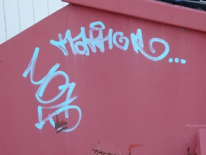 Can anyone decode this Dumpster graffiti for me? Love the style, as it is.